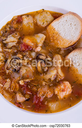 Seafood soup with bread close-up - csp72030763