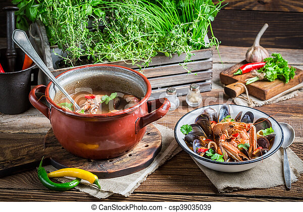 Seafood soup with langoustines and mussels - csp39035039