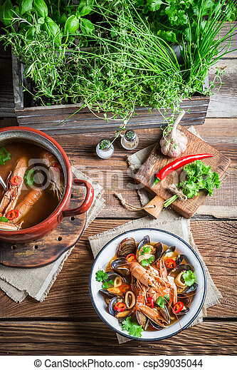 Seafood soup with mussels and shrimps - csp39035044