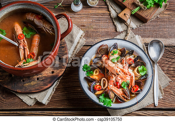 Seafood soup with mussels and langoustines - csp39105750