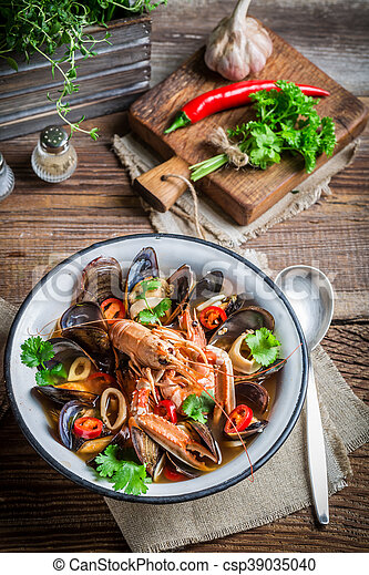 Seafood soup with mussels and langoustines - csp39035040
