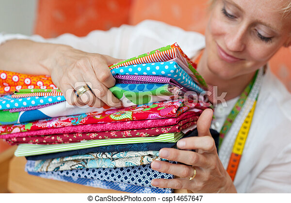 Seamstress choosing a fabric - csp14657647