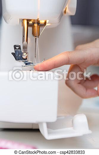 Seamstress put thread in needle - csp42833833