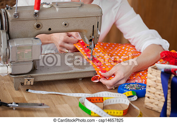 Seamstress with her sewing machine - csp14657825