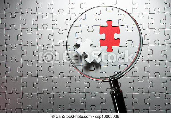 Search for missing puzzle pieces with a magnifying glass. - csp10005036