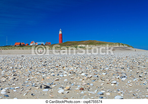 Seaside with sand dunes and lighthouse - csp6755574