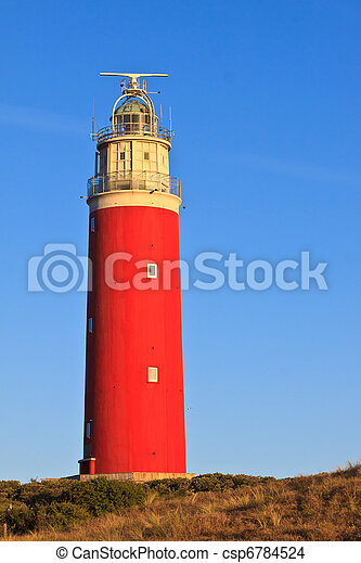 Seaside with sand dunes and lighthouse - csp6784524