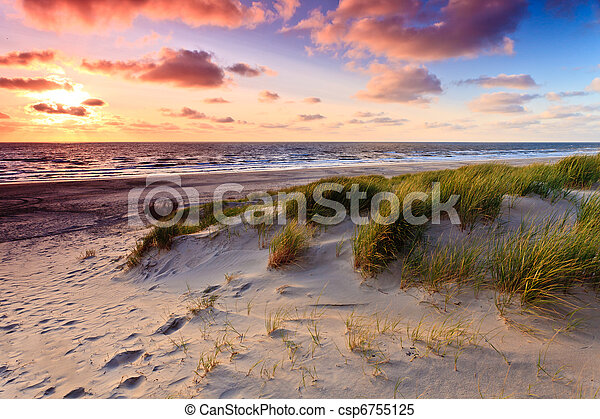 Seaside with sand dunes at sunset - csp6755125