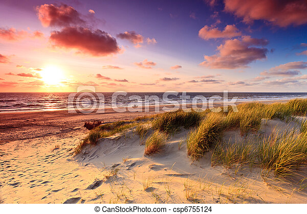 Seaside with sand dunes at sunset - csp6755124