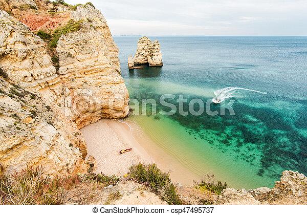 Secret beach on ALgarve coast in Portugal - csp47495737