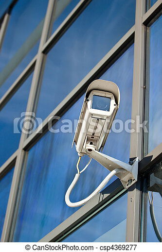 Security camera attached on business building with reflections  - csp4369277