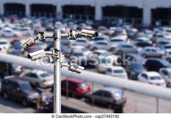 Security camera monitoring outdoor car park. - csp37493192