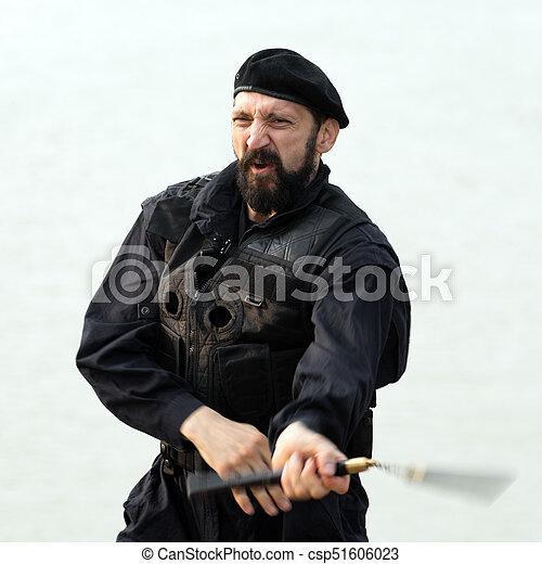 security man with nunchaku - csp51606023