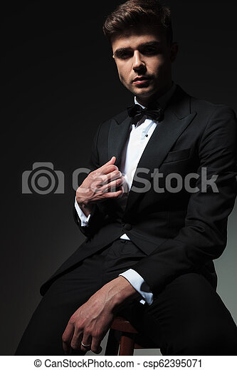 Magnificent Seductive Man In Black Tuxedo Sitting And Holding Collar Ocoug Best Dining Table And Chair Ideas Images Ocougorg