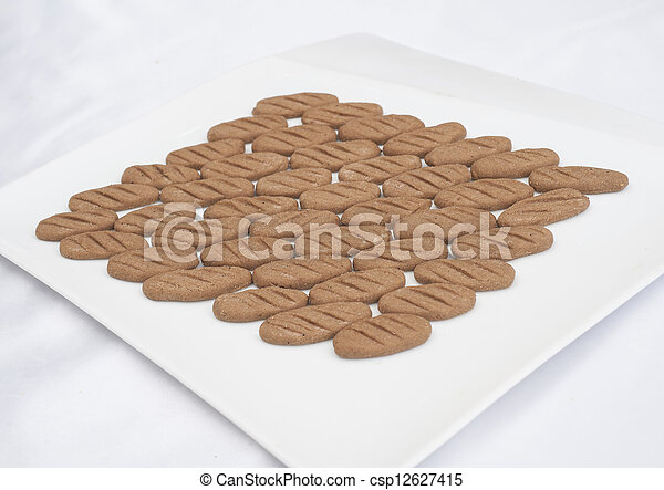 Selection of biscuits on a plate - csp12627415
