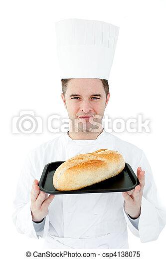 Self-assured chef holding a fresh bread  - csp4138075