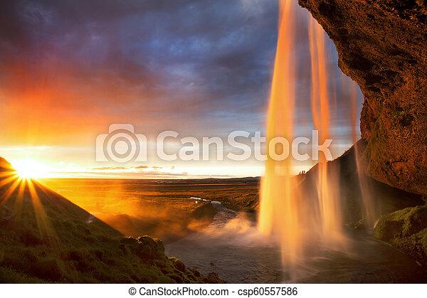 Seljalandfoss Waterfall at Sunset, Iceland - csp60557586