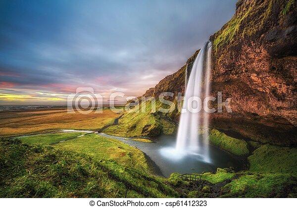 Seljalandsfoss Waterfall in Iceland at sunset - csp61412323