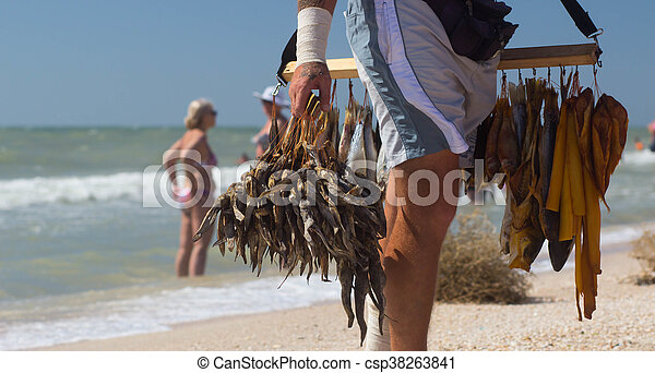selling dried fish at the beach - csp38263841