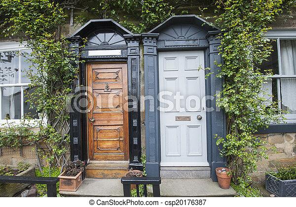 Semi-detached cottages in english village - csp20176387