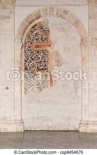 Semicircular niche with fresco remains in medieval castle church in Milazzo, Sicily - csp9454676