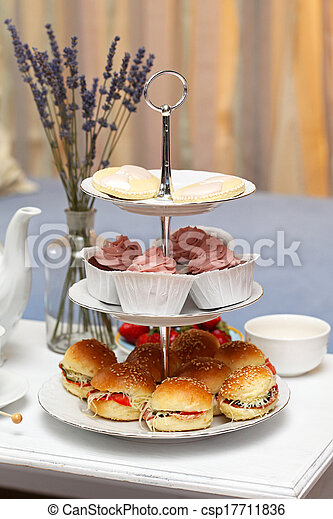 Sendwiches and cakes - csp17711836
