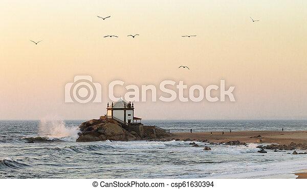 Senhor da Pedra Chapel and Seagulls at Dusk - csp61630394