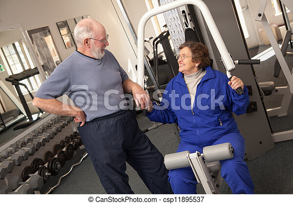 Senior Adult Couple Working Out Together in the Gym - csp11895537