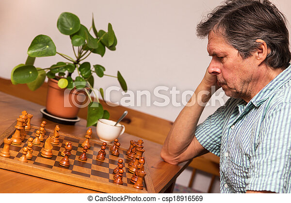 senior adult is playing chess - csp18916569