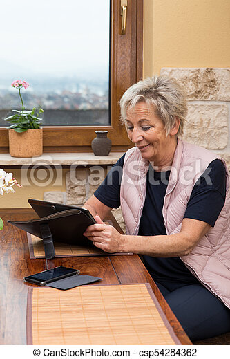 senior adult woman with tablet - csp54284362