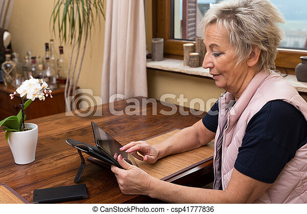 senior adult woman with tablet - csp41777836