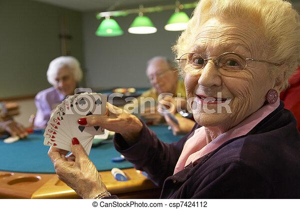 Senior adults playing bridge - csp7424112