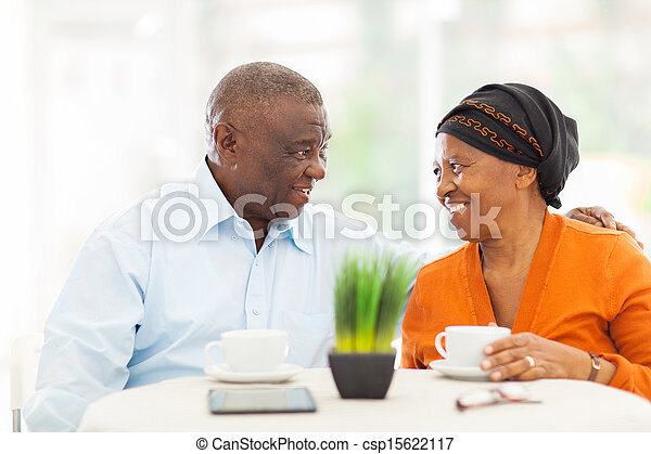 senior african couple relaxing at home - csp15622117