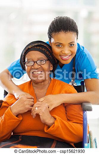senior african disabled woman caregiver - csp15621930
