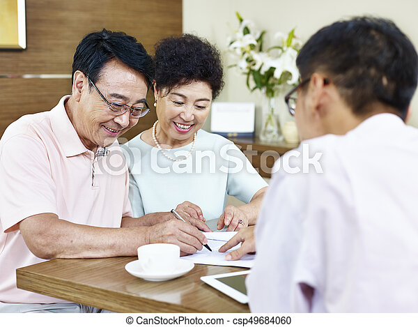 senior asian couple signing a contract - csp49684060