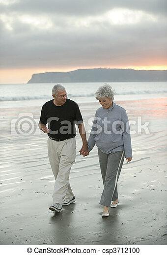 Senior Beach Walk Vertical - csp3712100