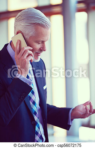senior business man talk on mobile phone - csp56072175