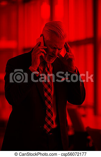 senior business man talk on mobile phone - csp56072177