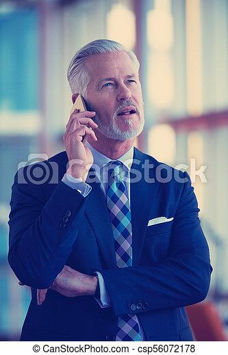 senior business man talk on mobile phone - csp56072178