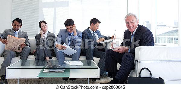 Senior businessman drinking a coffee - csp2860045
