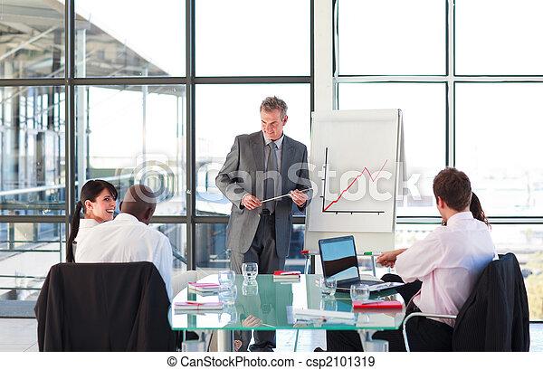 Senior businessman in a presentation - csp2101319