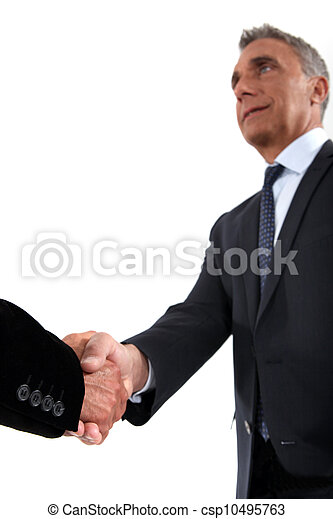 Senior businessman shaking hands - csp10495763