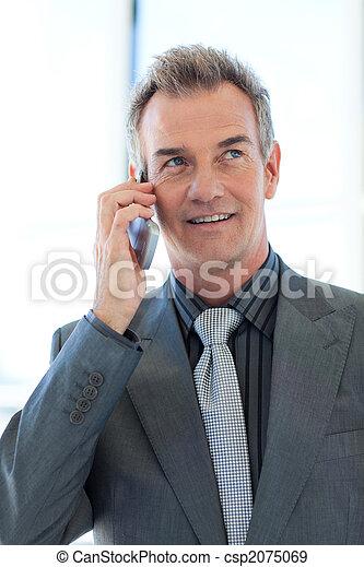 Senior businessman talking on phone - csp2075069