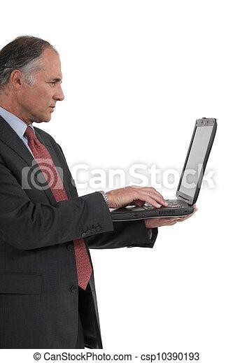 Senior businessman with a laptop - csp10390193
