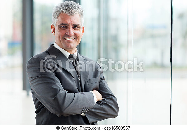 senior businessman with arms crossed - csp16509557