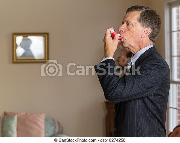 Senior businessman with asthma inhaler - csp18274258
