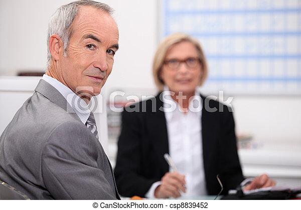 Senior businesspeople in interview - csp8839452