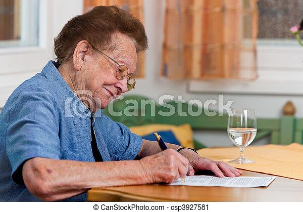 Senior citizen signs a contract - csp3927581