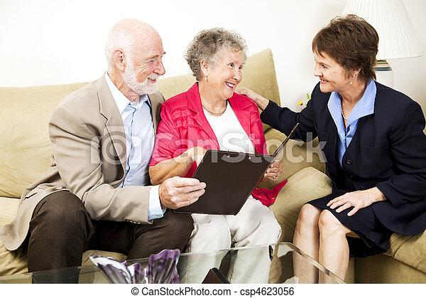 Senior Couple and Saleswoman - csp4623056