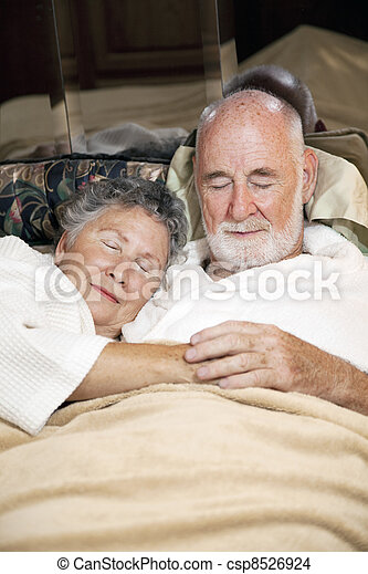 Senior Couple Asleep - csp8526924